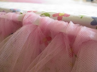 tulle bedskirt...how cute is this? & im capable of making it-just no girls to make it for :( wonder if Bob would mind a pink tutu around our bed ;)