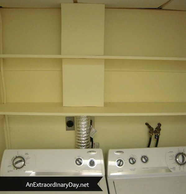 To hide dry vent... Add shelves above washer and dryer.  Measure cardboard to fit between the shelves, and paint both sides of it (so it doesn't curl) ..Removable if you need to get to the vent, but hides it easily!  She also made a no-show curtain to hide everything under the bottom shelf...