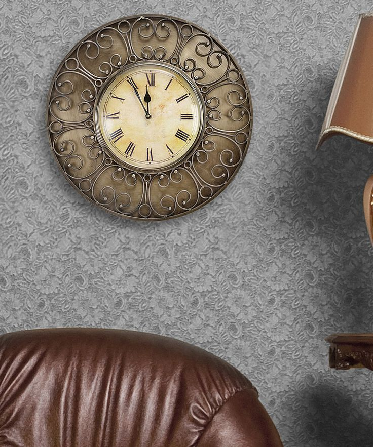 This beautiful wall clock features round brass frame with brass antique finished in yellow gold. Elegant golden carvings decorate the interior wire frame. The beige clock face give vintage look to your room.