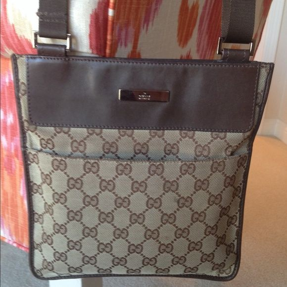 """Authentic Gucci messenger bag This 100% authentic Gucci Crossbody bag is a great size. It measures 10 by 9"""". It has a pocket on outside front and back. Also a zipper compartment inside. More images are available upon request. Gucci Bags Crossbody Bags"""