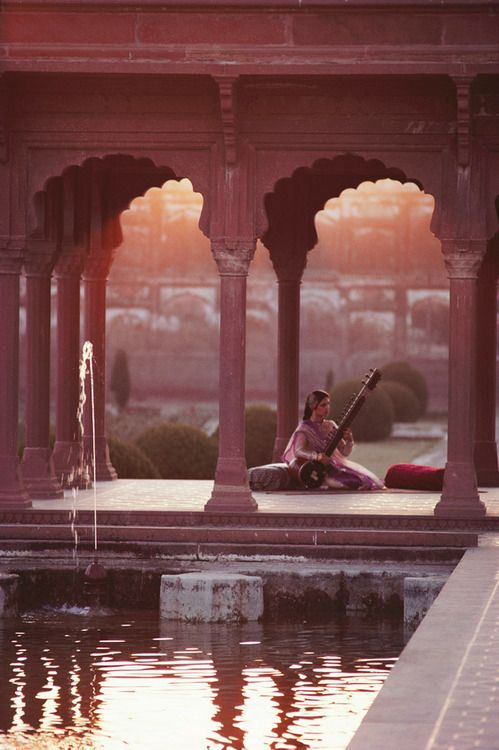 """ LAHORE, PAKISTAN. 1981. Tahira Sayed playing the sitar in the Shalimar Gardens. Photograph by Roland and Sabrina Michaud. """