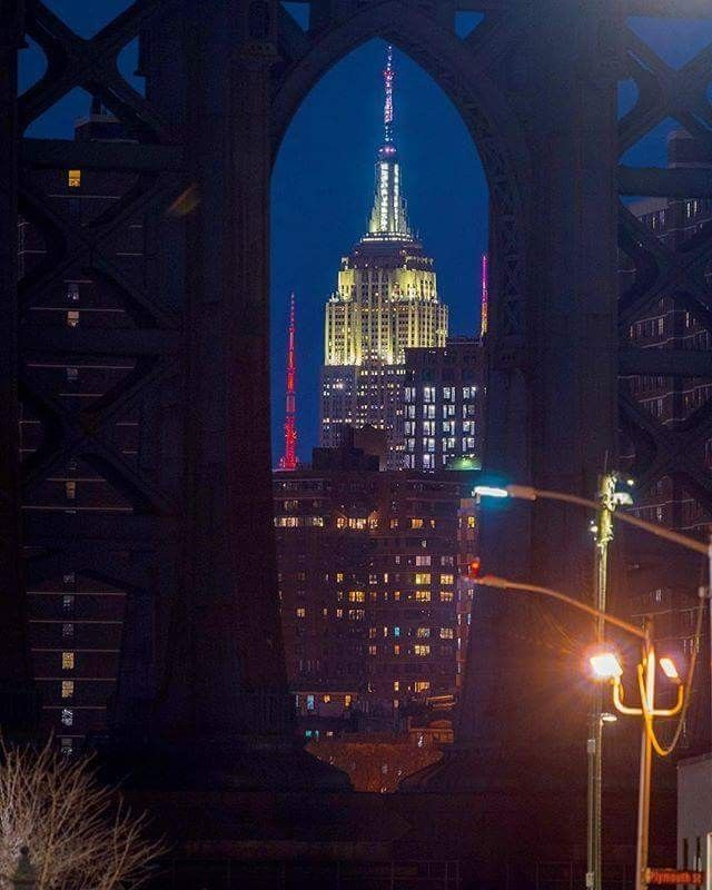The Empire State Building Photographed Through The Eastern Legs Of The Manhattan Bridge Empire State Building Nyc Pics New York Pictures