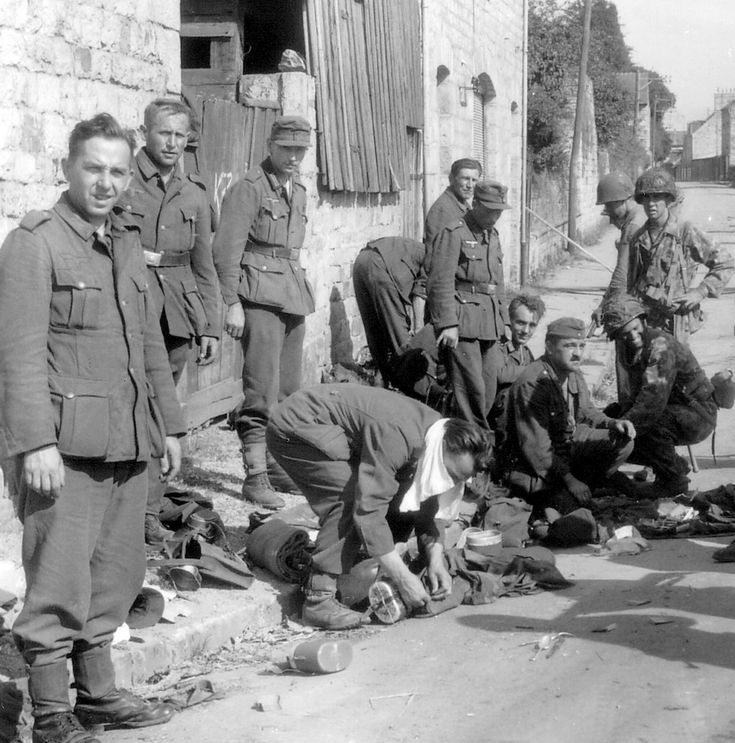 German soldiers surrendering. Rue des Fossés Plissons in Domfront, Orne, France, 1944. (Jo Hedwig Teeuwisse)