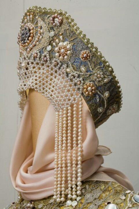"Ornate kokoshnik or ""window"" headpiece, heavily decroated with beads and jewels."