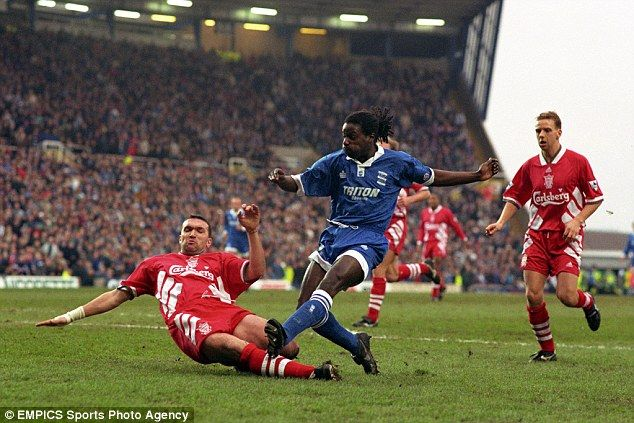 Ruddock (left), nicknamed 'Razor' in his playing days, tackles Birmingham City's Ricky Ott...