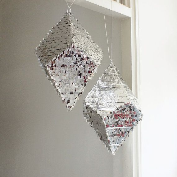 Get the party started with a geometric silver piñata.