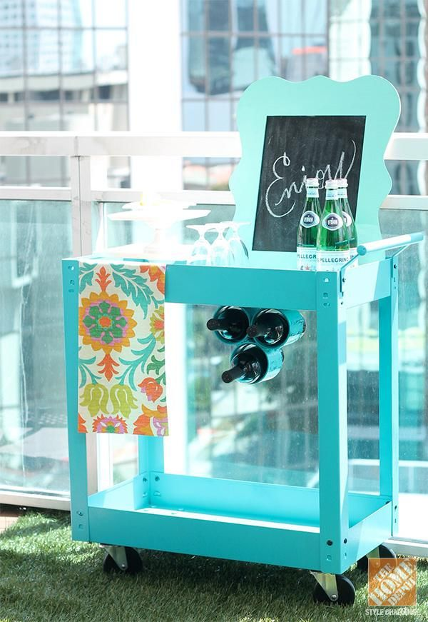 This repurposed beverage cart looks smashing on blogger Amber Kemp-Gerstel's Miami apartment balcony. Check out the faux grass, too!