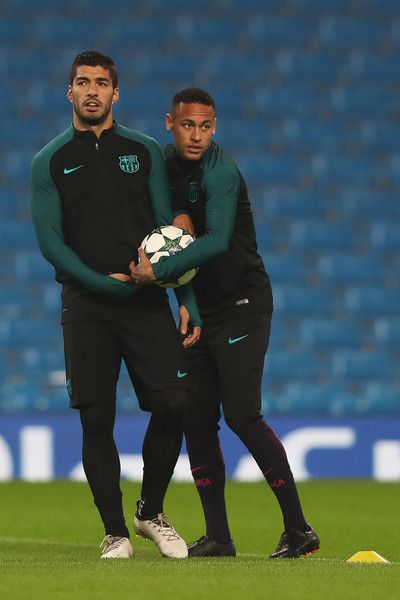 Luis Suarez (L) of Barcelona looks on next to team-mate Neymar during a training session ahead of the UEFA Champions League match between Manchester City and Barcelona at the City Football Academy  on October 31, 2016 in Manchester, England.