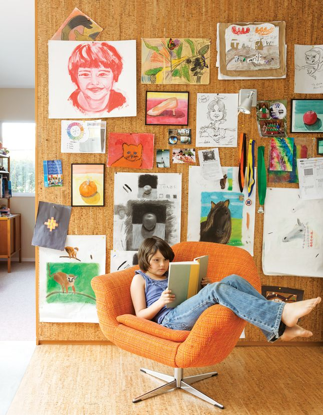 The pair's art covers a cork wall where Eva Luna reads in a vintage Danish lounge chair. Photo by: Lisa Romerein | Read more: http://www.dwell.com/articles/The-Homemakers.html