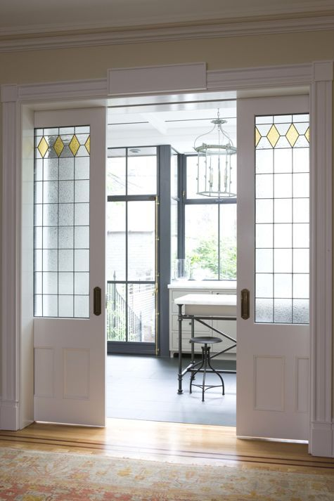 THE IMPRESSIVE DUTCH REVIVAL row house in Brooklyn Heights. Sliding pocket doors between the dining room and new kitchen extension were designed to complement original leaded glass elsewhere in the house.