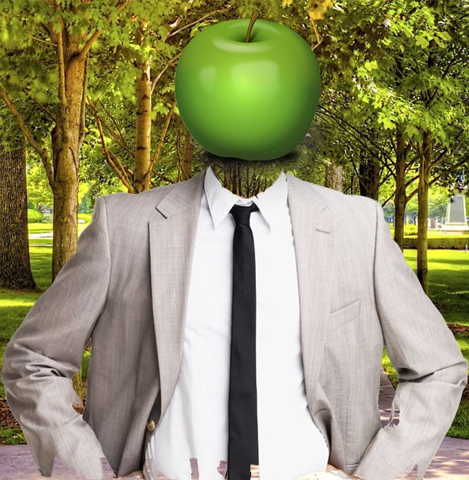 A man with the head of a green apple.