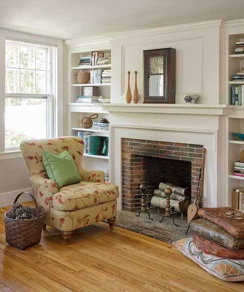 farmhouse whole house remodel living room with new fireplace mantel and built-in bookcases
