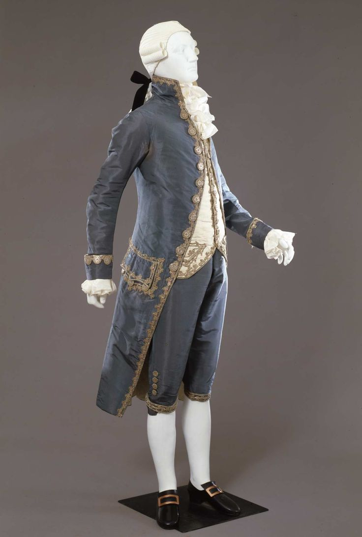 3-piece suit, Italy, late 18th century. Dark turquoise silk taffeta, embroidered with floral motifs in silver thread, sequins, foil in green and red; waistcoat: ivory silk taffeta with similar embroidery.