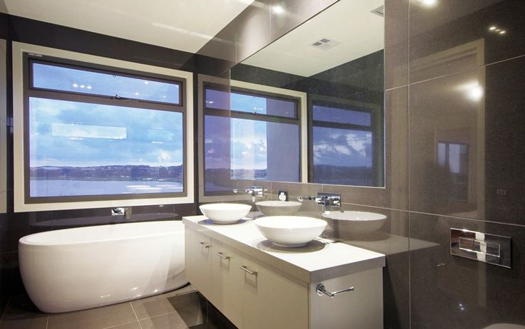 Fabulous ensuite bathroom with water views. This design has used Caroma Track tapware to great effect along with a Decina Sheraton Acrylic freestanding bath.  http://www.caroma.com.au/bathrooms/mixer-taps/track