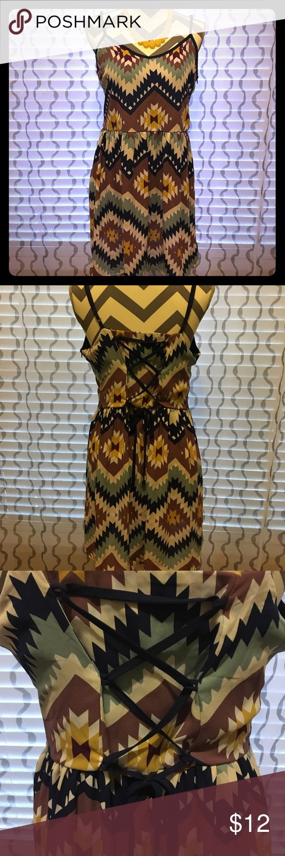 Aztec printed sleeveless dress with pockets Xhiliration Aztec print dress. Back of dress has cross cross detail and tie! Xhilaration Dresses