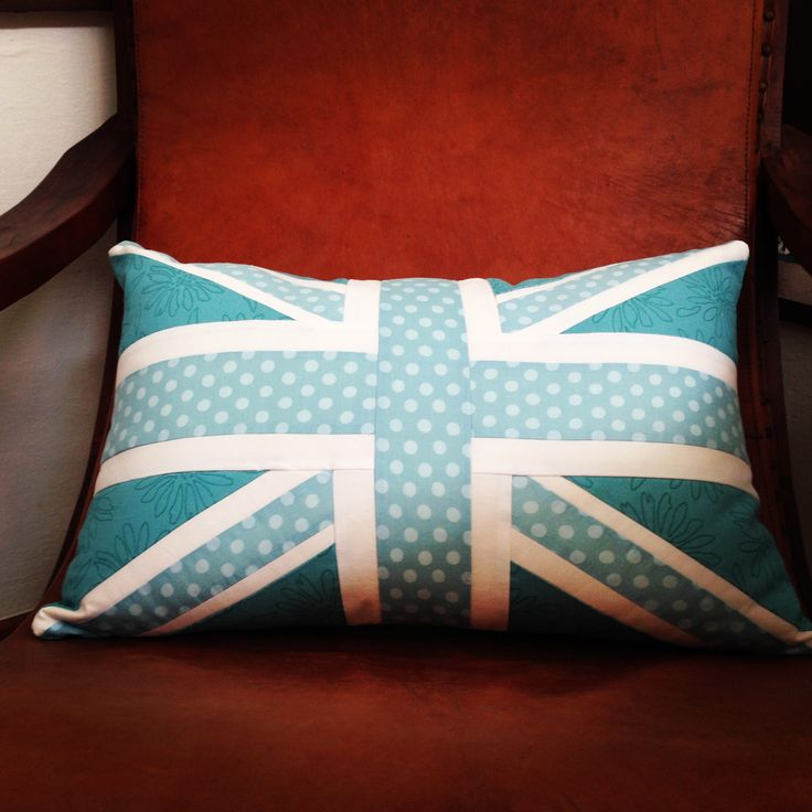 Teal and Turquoise Union Jack Cushion available from Jam and Jerusalem