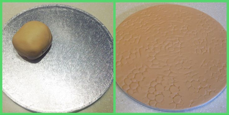 Roll out a circle of brown fondant onto a silver cake base and make cobblestone indentations