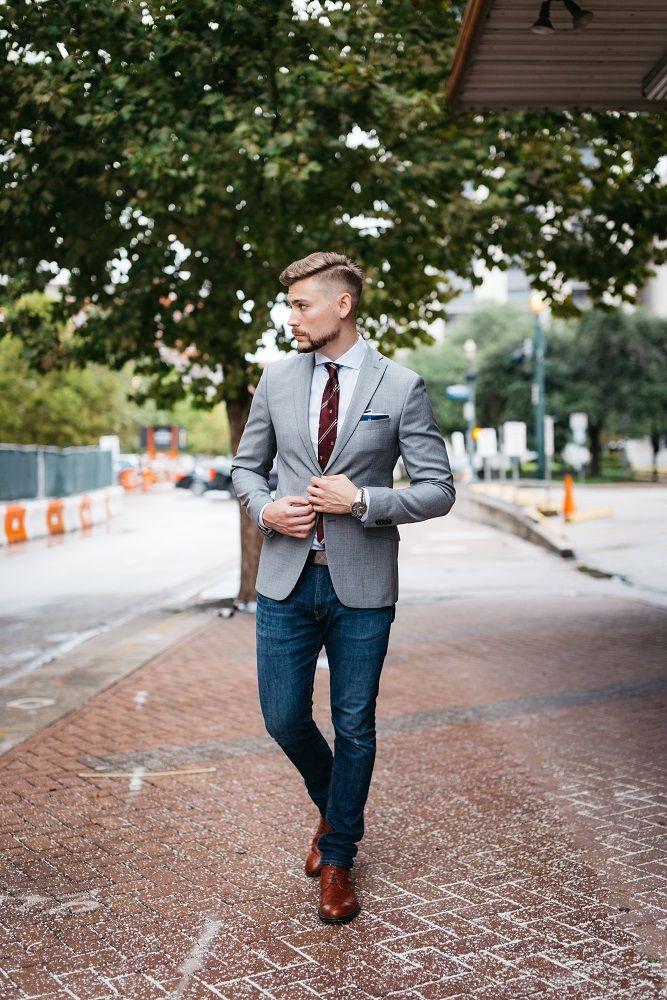 Gray blazer + burgundy tie + navy pocket square + pinstripe dress shirt + jeans + wingtip boots