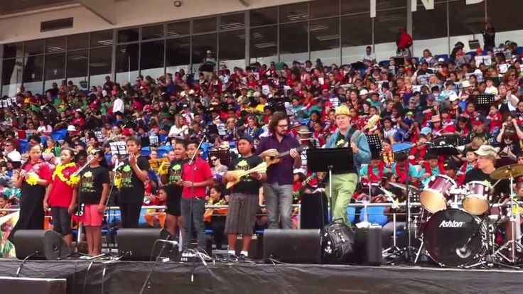 NZ Ukulele Festival - Paradise being performed by close to 3000 children on ukulele with special guest James Hill - Maria Winder leading.