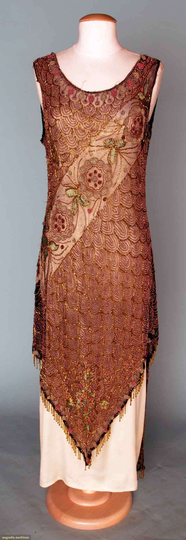 BEADED & EMBROIDERED PARTY DRESS, 1920s  Black net, copper scallop motifs on F & B, broken by wide diagonal band w/ blossoms & foliage in blue & pink metal beads & teal blue silk embroidery, front hem comes to center V point, longer back square hem w/ center split