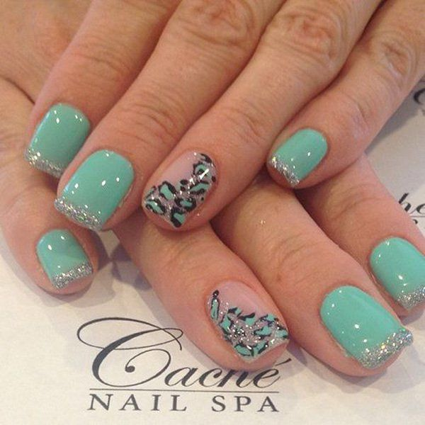 Sea green nail polish with silver glitter French tips and animal print in black and sea green details.