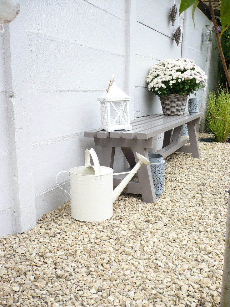 watering can, bench, plant