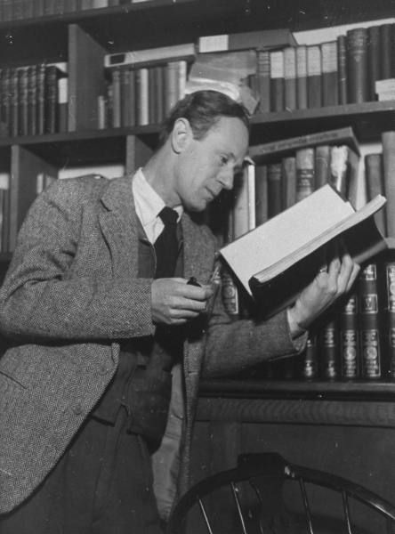 Actor Leslie Howard reading in his home library, England, 1941.