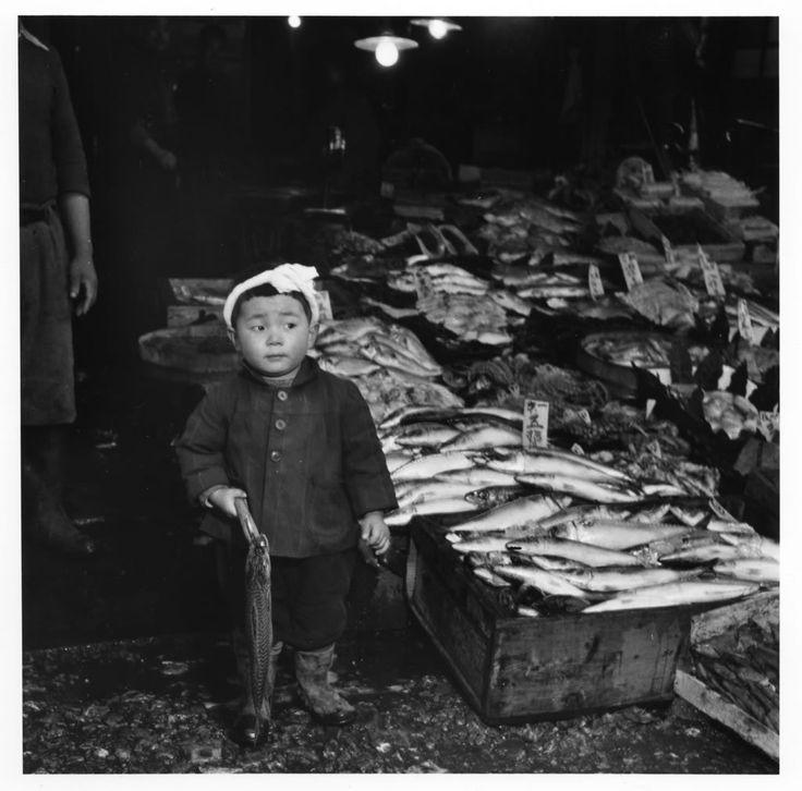 Tokyo, 1949 by Shigeichi Nagano. Young boy in headband at fish market.