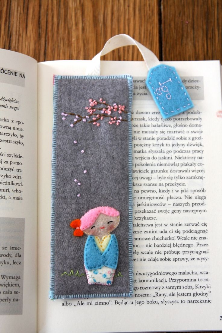 Felt kokeshi doll on a bookmark. it was a gift for my best friend given along with a book :)
