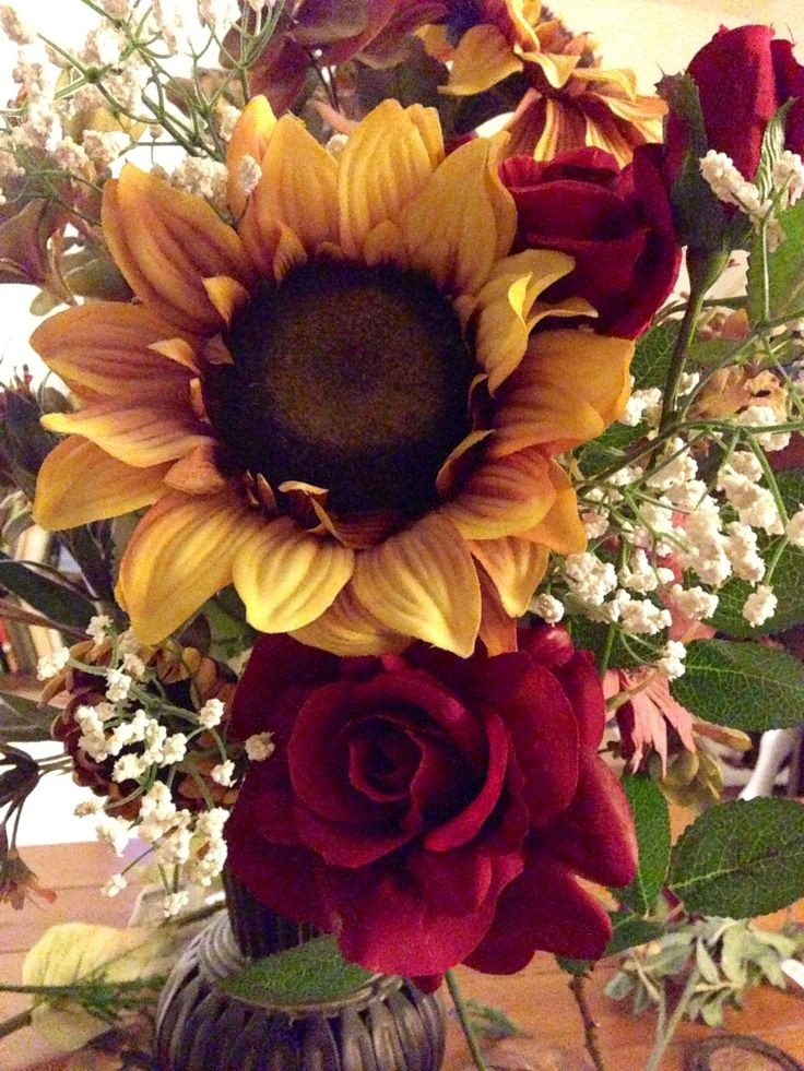 Red roses, sunflower, and baby's breath. Bridesmaid bouquet idea!