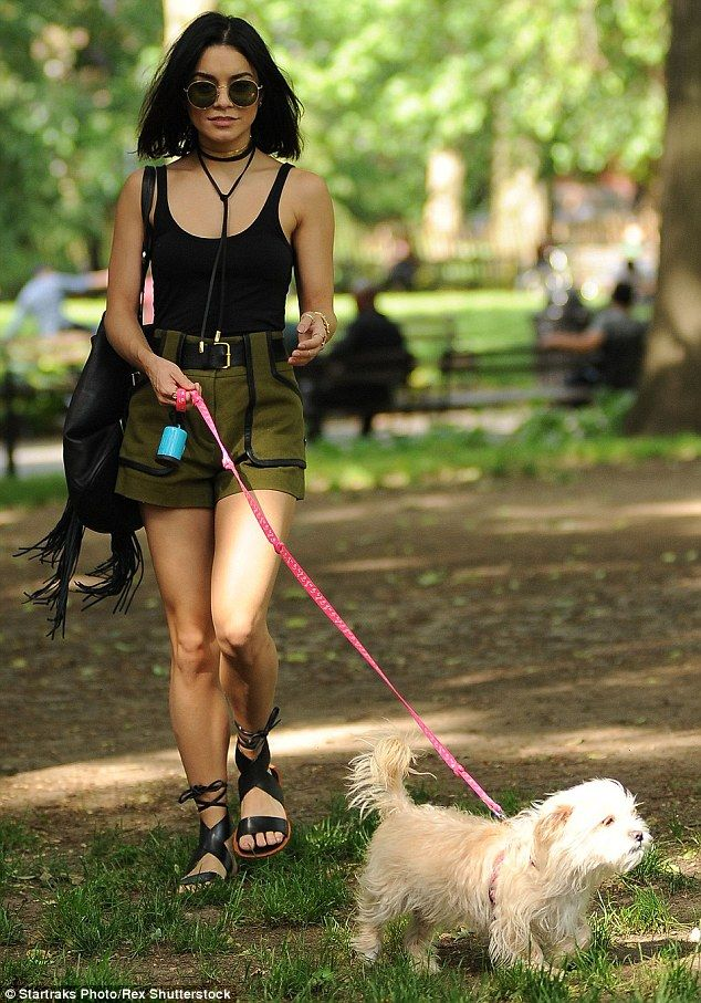 Vanessa Hudgens displays her legs in high-waisted shorts to walk dog