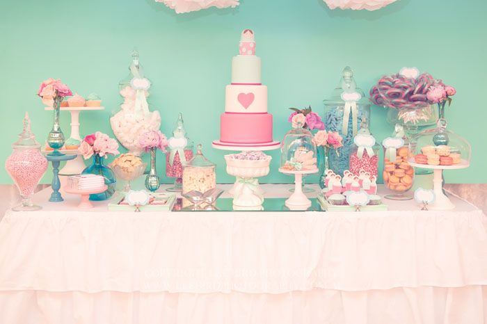 Sweets table was styled for a Christening. (Babushka/Matryoshka theme - soft with the turquoise and pink color palette). Sweet treats included vanilla bean babushka cookies, macarons, mini yo-yos, and the beautiful cake designed by Juli from One Sweet Girl. Photography by Lee Bird Photography.
