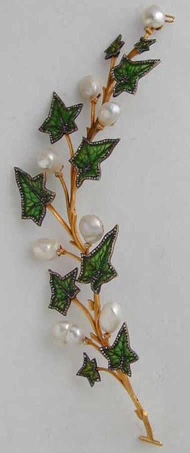 An Art Nouveau enamel, diamond and pearl ivy spray tiara, circa 1900. Designed as a meandering ivy spray with ten leaves in green plique à jour enamel highlighted with rose-cut diamonds, alternately set with natural baroque pearls and two natural blister pearls each with an old-cut diamond at its base, naturalistically arranged along a yellow gold stem, bearing control marks for the Netherlands, 18cm long. #ArtNouveau #tiara