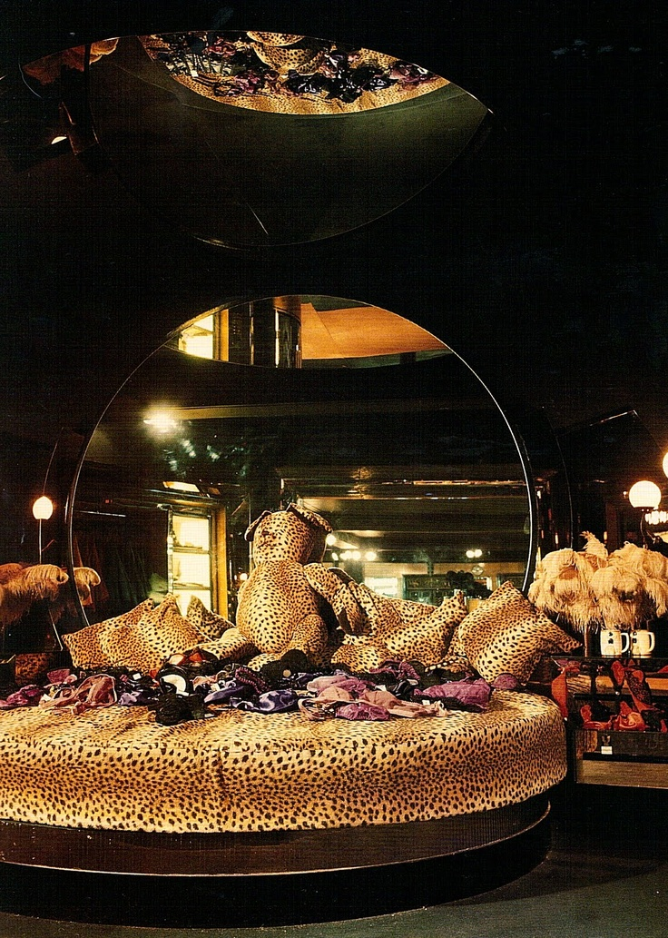 Circular mirror & bed covered in faux leopard complete with leopard teddy. Big Biba home dept