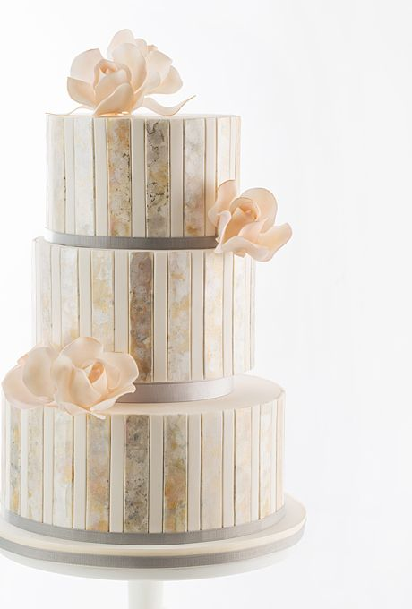 Brides.com: 34 Stunning Wedding Cakes for a Winter Wedding | Metallic striped cake with flowers by AK Cake Design