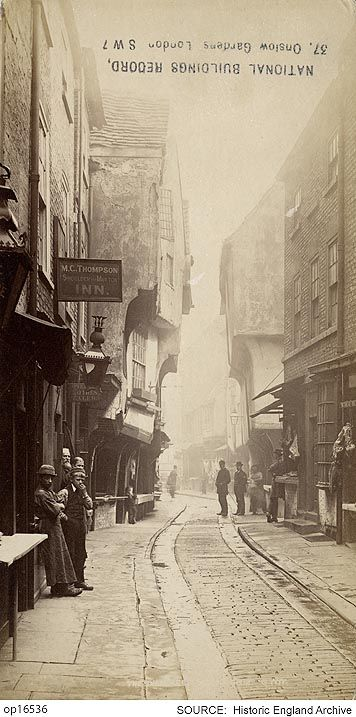 OP16536A view looking along The Shambles with the pub sign for the Shoulder of Mutton Inn, landlord M C Thompson, is hanging in the foreground.  This is stuck on the reverse of a photograph of Greenwich Hospital.  Date 1855 - 1895 Format 1 Photograph (albumen print) (+1)  Photographer: George Washington Wilson and Company
