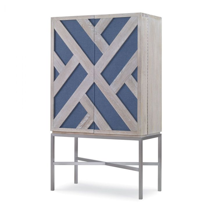 From the Mabley Handler for Kravet Furniture Collection, the Halsey Grasscloth Bar (WSB108-G) features fingerpull magnetic latch doors wallpapered with Mabley Handler for Kravet's grasscloth wallpaper W3407-52.  The hand-carved lattice overlay is finished