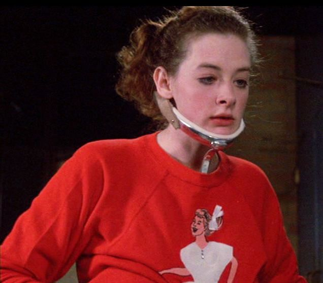 Joan Cusack in Sixteen Candles (1984) This a nerd girl...not a chick with tiny shorts and black framed glasses.