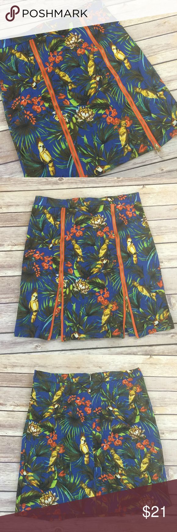 Tropical Bird Pencil Skirt Mini Zipper Slits Worn once. Stretchy easy to move in. Comfortable.  The zippers can unzip as much or little as you want.  This is a denim skirt. Great colors for bringing the fun into fall. the lift Skirts