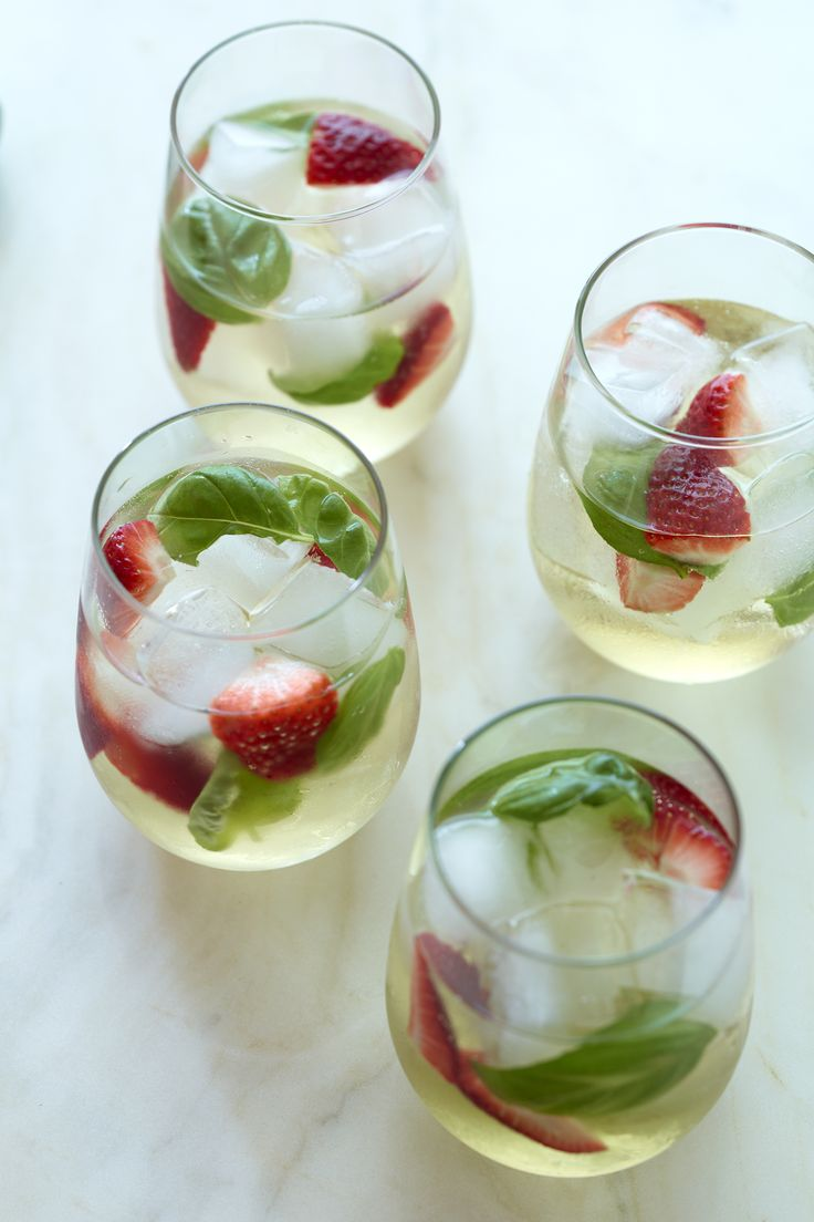 Sweet strawberries and tangy basil infuse a dry, white sangria.