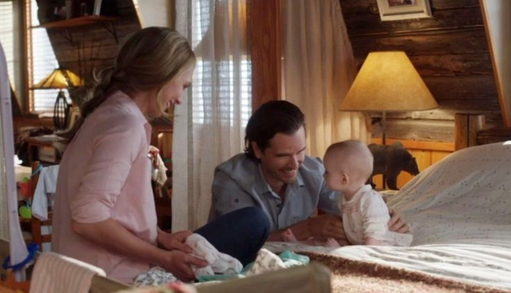 11 x 03 Lyndy listening to Ty and Amy watching while folding baby cloth.