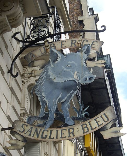 "18th arrondissement - the hanging sign for the ""Auberge du Sanglier"" at 102 boulevard de Clichy."
