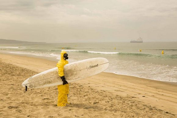 Pollution is damaging our oceans and photographer Michael Dyrland reveals an eerie photo project showing that we may soon have to surf while wearing hazmat suits. #art #portrait #ocean #pollution #photography