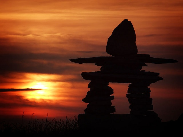 Inukshuk Sunset, Newfoundland, Canada. This is a  Northern Native symbol for Friendship. Used in the Winter Olympic Games in Vancouver in 2010.