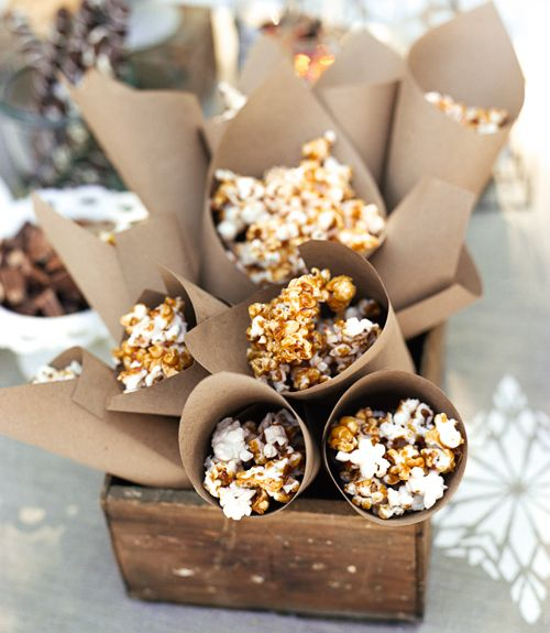 Caramel Syrup and Chocolate Covered Popcorn - love the craft paper cones!