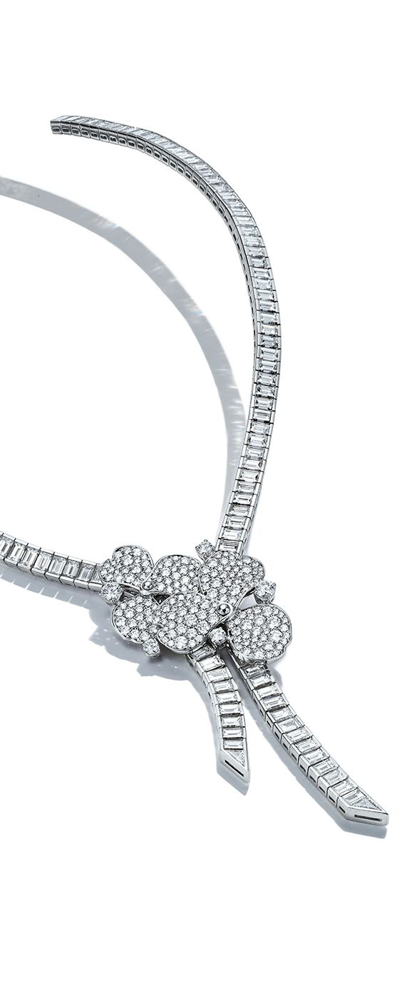 A striking new Tiffany Paper Flowers™ high jewelry design in platinum with  brilliant diamonds. 02274420b431