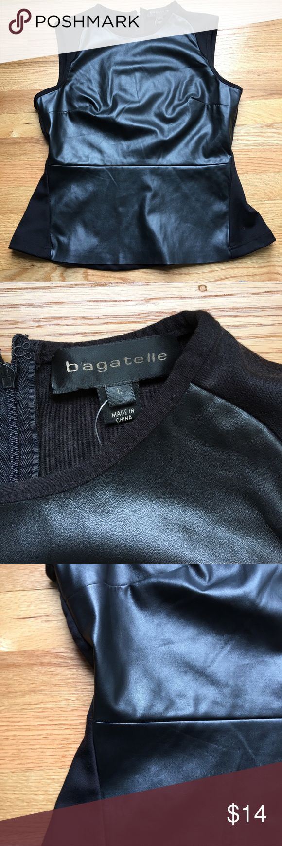 "Vegan Leather Peplum Top Black Sleeveless Large New with tags! Please see Small pinholes near the neckline, not very noticeable. Size Large 21"" across at bust, 24"" long bagatelle Tops"