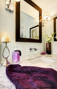 "Carrara marble vanity with ""Love Me"" waterfall faucet"