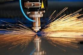 I really like this photo because the sparks flying off the machine look so cool. They're so defined they look like you could actually grab them like straw. It's also neat to see the different shades of color in the sparks, probably representing how soon the were just created. At the center of the sparks there is a blue light which is the hottest point of the sparks. Very cool