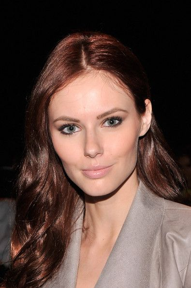 Alyssa Campanella's soft pink lips pleasantly contrast her lustrous auburn hair.